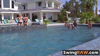 naughty couples having fun in pool