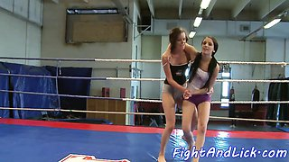 Wrestling lesbo fingers pussy and licks clit