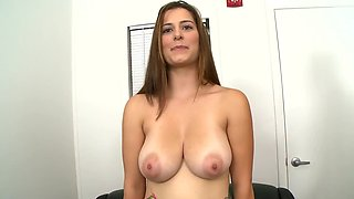 Newcomer with big tits gives partner blowjob at casting
