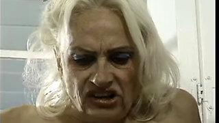 Demanding granny analyzed by two cocks