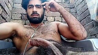 hairy guy tugging his big dick outdoor living