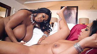 Ebony busty madames spend her day with big dildo and strapon