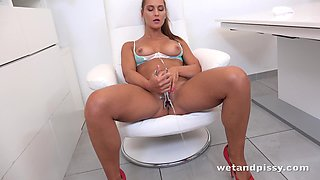 Sexy nurse in uniform Naomi Bennet is pissing and masturbating snatch