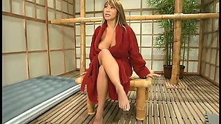 Busty cougar Ava Devine is in an oiled up machine glory