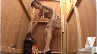 Woman pissing gets spied on voyeur cam with stretched legs