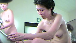 Slim Asian bimbo possesses awesome cleavage shot in shower dvd 03019