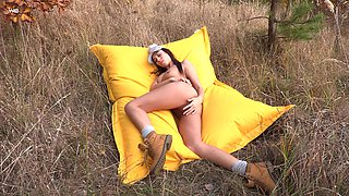 Cutie Sabrisse with trimmed pussy playing naked in the outdoors