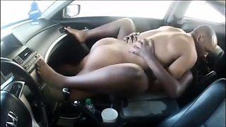 Voluptuous ebony babe has sex with a black stud in the car
