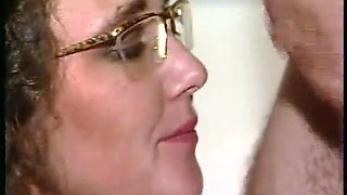 German girl with glasses gets a cumshot