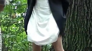 Woman in skirt and other in pants peeing