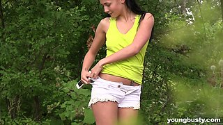 Sweet and pretty babe Nicole Love goes solo to masturbate on fresh grass