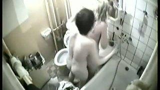 Two lesbian cuties filmed on a hidden shower cam