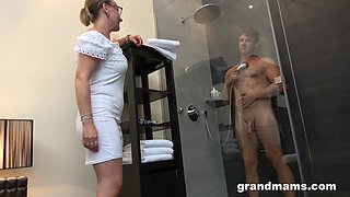 Old woman with high sex drive enjoys watching young man taking a shower before having sex