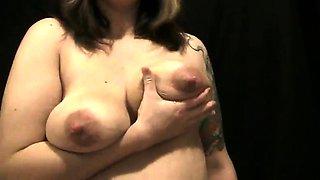 Sensual mature brunette with big hooters milks her nipples
